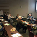 Midwest Chestnut Producers Council members Pete Conrad and Carl DeKleine lead a grower innovation discussion about pollination at the 2018 membership meeting. (Photo by Erin Lizotte, MSU Extension)