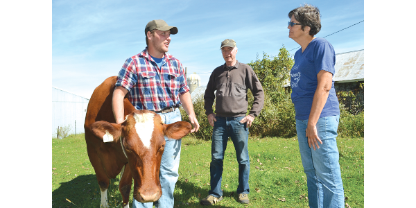 Bryton Miller, shown with Bonnie and Bill McMillin. (Courtesy of Farm Stewardship Project)