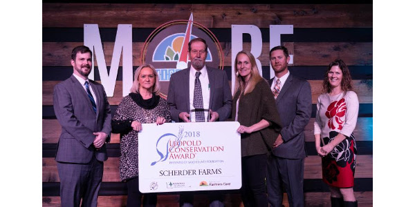 Scherder Farms of Frankford, Mo., was announced as the 2018 Missouri Leopold Conservation Award recipient on Thursday, Jan. 10, at the 48th Missouri Governor's Conference on Agriculture. Pictured (L-R) Sand County Foundation National Director for the Leopold Conservation Award Lance Irving, Sandy and John Scherder, their daughter and son-in-law, Holly and Curtis Delgman, and Missouri Farmers Care Executive Director Ashley McCarty. (Courtesy of Missouri Farmers Care)
