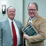 Missouri Corn Growers Association CEO Gary Marshall (left), presents retiring Missouri Farmers Care Chairman Alan Wessler D.V.M. (right) with an award for outstanding contributions at the Missouri Farmers Care 2018 Annual Meeting, Thursday, Jan. 10. Missouri Farmers Care members elected Marshall as incoming chairman. (Courtesy of Missouri Farmers Care)