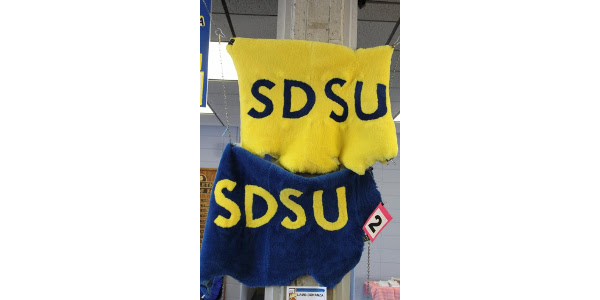 "During the men's halftime, six lamb pelts will be auctioned. Four pelts will feature the letters ""SDSU"" and two will feature the SDSU Jackrabbit mascot Auction proceeds provide scholarships to undergraduates enrolled in the SDSU Department of Animal Science and the SDSU Athletic Department. (Courtesy of SDSU)"