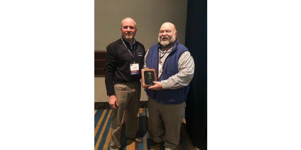 Kevin Nelson, CCA (right), Ottawa, Illinois, receives the 2019 CCA Soybean Master Adviser award from David Wessel, Illinois Soybean Association district director, at the 2019 ILSoyAdvisor Soybean Summit in Springfield, Ill. (Courtesy of Illinois Soybean Association)
