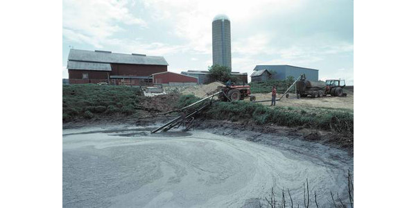 Liquid manure storage pit at a dairy operation. (Photo by USDA Natural Resources Conservation Service)