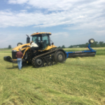 Organic no-till farmer, Scott Shriver, uses a roller/crimper on rye cover crop prior to planting soybeans. (Courtesy of ISU Extension and Outreach)