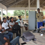 Scott Massey, founder of hydroponics startup Heliponix, discusses agricultural innovations with Togonese students as a part of his first Mandela Washington Fellowship. In 2019, Massey will workshop at Cameroonian universities, empowering students interested in agricultural innovation and entrepreneurship. (Photo provided)