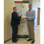 CEO Jeff Troike also presented more than $6,000 to Indiana 4-H Foundation's Shelly Bingle, to fund the youth leadership programs of Round-Up, Junior Leaders Conference and a 4-H Scholarship. (Courtesy of Ceres Solutions Cooperative)