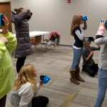 4-H seeks to close the gender gap in STEM careers by providing hands-on, technological activities and career exploration. Here, girls explore new worlds with the help of virtual reality goggles at a GEMS program facilitated by 4-H staff. (Courtesy of University of Illinois Extension)