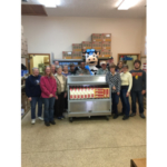 Mootila, the Milk Means More mascot, and members of the Greater Lansing Food Bank with a milk cooler donated by the United Dairy Industry of Michigan. Food pantries can now provide more fresh milk to their clients. (Courtesy of United Dairy Industry of Michigan)