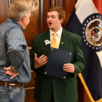 Blake Wright, Greene County 4-H member, has a conversation with Governor Mike Parsons during 4-H Legislative Academy. (Photo credit: University of Missouri Extension)
