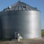 Monitor the moisture content and temperature of stored grain in the spring. (NDSU photo)