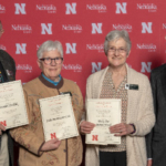 Dan Stehlik, Judy Bowmaster-Cole and Ricky Sue Barnes Wach, DVM, were recognized March 1 by the UNL Parent Association. NCTA Dean Ron Rosati applauds their dedication to students and NCTA. (UNL University Communication Photo)