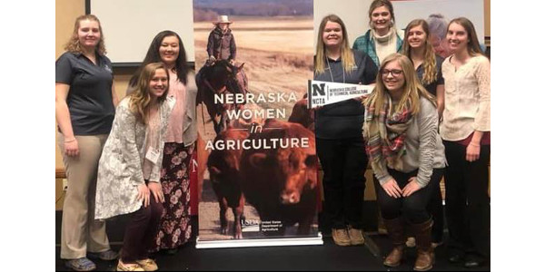 Women in Agriculture from the Nebraska College of Technical Agriculture who attended the Nebraska Women in Ag conference Feb. 21-22 were, (left side of poster) Chantelle Schulz, Aurora Urwiler and Kayla Mues, and (right of poster) Jocelyn Kennicutt, front, Emily Giese holding pennant, Assistant Professor Meredith Cable, Tiffany Dickau, and Catherine Ljunggren. (J. Kroeger / NCTA Photo)