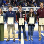 Agriculture Commissioner Ryan Quarles, left, presents Honorary Commissioner of Agriculture certificates to the 2019 KHSAA-KDA Ag Athletes of the Year, from left: Kailey Thompson, Taylor County; Benjamin Sapp, Russell County; Marcus Wiseman, George Rogers Clark High School; Alleson Short, Muhlenberg County; Tyler London, Metcalfe County; and Morgan Belcher, Pulaski County. (Photo by Walter Cornett/KHSAA)