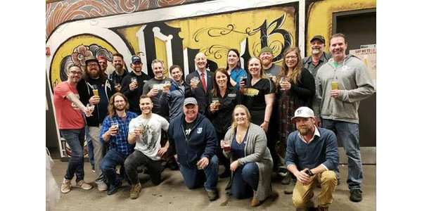 """Governor Ricketts and craft brewers host a """"Raise Glasses, Not Taxes"""" event at Brickway Brewery & Distillery in Omaha. (Courtesy of Office of Governor Pete Ricketts)"""