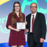 ASA President Davie Stephens (right) presents the 2019 Soy Scholarship to Jessica Olson (left) during ASA's annual Awards Banquet in Orlando during Commodity Classic. (Courtesy of ASA)