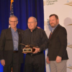 National Farmers Union recognized Amherst farmer, Paul Symens (center) with the organizations highest honor during the 117th National Convention held in Bellevue, Washington March 3-5, 2019. He is pictured here with NFU President, Roger Johnson (left) and SDFU President, Doug Sombke (right). (Courtesy SDFU)