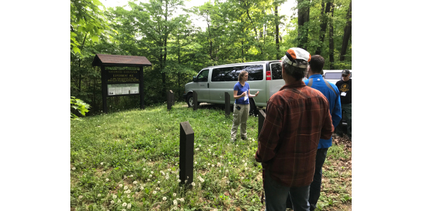 Charlotte Owings, Hardwood Ecosystem Experiment project coordinator, talks with a group about some of the results from on-going forestry and wildlife research in southern Indiana. (Courtesy of Purdue University)