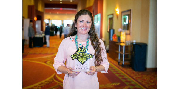 Chelsea Deering accepts the 2018 Safe Farm Award on behalf of D&D Feedlot West of Iliff, Colo. (Courtesy of Colorado Livestock Association)