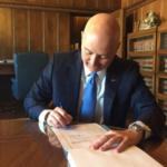 Gov. Ricketts signs LB 302 creating the Department of Environment & Energy. (Courtesy of Office of Governor Pete Ricketts)