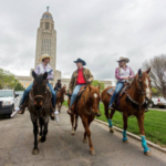 Governor Pete Ricketts rides down Goodhue Boulevard with members of the UNL Rodeo Team in front of the Nebraska State Capitol to celebrate Rodeo Week. (Courtesy of Office of Governor Pete Ricketts)