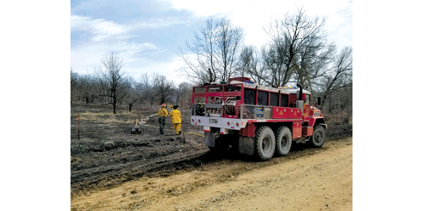 Members of the Marion County Wildland Fire Task Force work on a progressive hose lay. Fourteen members of the task force participated in the dispatch exercise for the Kansas Forest Service Hazardous Fuels Mitigation Project on March 26, 2019. (Courtesy of K-State Research and Extension)