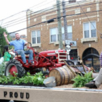 Agriculture Commissioner Ryan Quarles (on tractor) and friends wave to onlookers at the 2018 Pegasus Parade. (Kentucky Department of Agriculture photo)