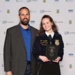 The Minnesota Farm Bureau Federation (MFBF) and the Minnesota Farm Bureau Foundation worked with the Minnesota FFA to sponsor the 17th FFA/Farm Bureau Discussion Meet competition on April 28. Pictured left to right are Jim Burns - past president Minnesota FFA Alumni and Jenna Skarphol of the Forest Lake FFA Chapter winner of the Discussion Meet. Martha Moenning of the Triton FFA Chapter took second place. Luke Fonkert of the Dassel Cokato FFA Chapter and Nolan Mattison of the Maple River FFA Chapter also advanced to the final round. (Courtesy of Minnesota Farm Bureau)