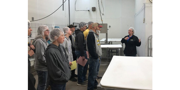 Baili Maurer explains the steps for processing meat at the Edgewood Locker to Delaware County 4-H and FFA members. (Courtesy of ISU Extension and Outreach)