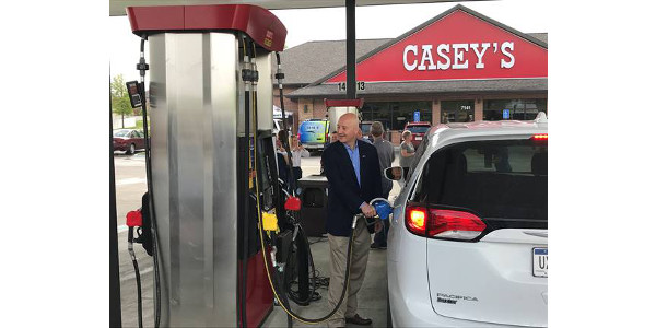 Governor Ricketts fills a customer's tank with E15 at a new flex fuel pump after designating May as Renewable Fuels Month. (Courtesy of Office of Governor Pete Ricketts)