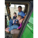 Oehlke, pictured in the combine cab with two of his children, speaks from experience. He is a third-generation Hartford farmer. (Courtesy photo)
