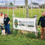 Rich and Michele Joseph and son Joe Lang stood by their hop yard near Belleville. (Courtesy of Wisconsin Farm Bureau)