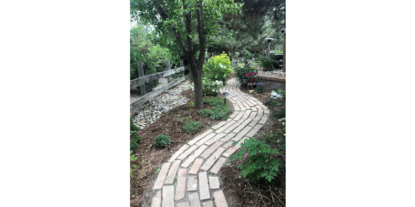 Hardscapes like paths and stone can add different textures and colors to your landscape. (Courtesy of Andie Wommack, Douglas County Extension)