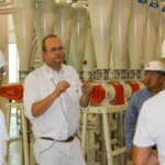 Michael Albers, Buhler milling instructor, discusses milling flow while leading executive milling participants through the Hal Ross Flour Mill. (Courtesy of KSU)