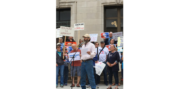 Barron County Farmers Union member Jim Hare of Prairie Farm is shown at Monday's rally in Eau Claire voicing support for acceptance of federal Medicaid funds and needed measures to improve health care access and affordability for farmers and other self-employed individuals. (Courtesy of WFU)