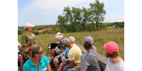 Kirsten Jurcek of Brattset Family Farm shared conservation practices on the farm at a 2016 farm tour. Jurcek will host a June 18th twilight pasture walk focused on grazing's impact on groundwater. (Courtesy of WFU)