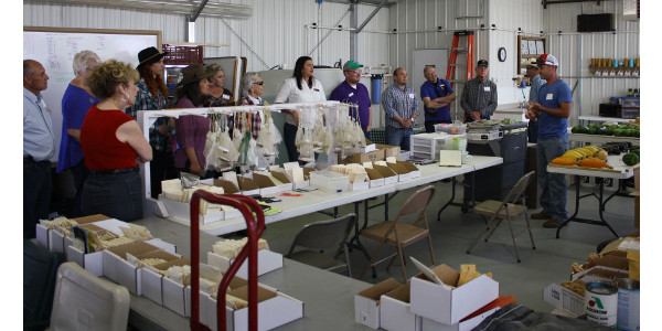 Jacob Froese, Froese Farms and Colorado Seeds, Inc., Cheraw, CO, explains the process of producing, packaging, and distributing seed for produce growers. Colorado Seeds specializes in melons and other gourd plants. (Courtesy of Norman L. Kincaide)