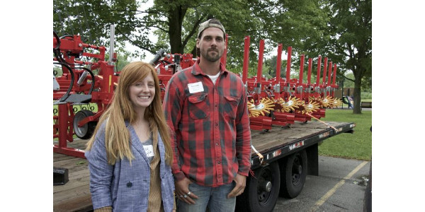 "Casey Lynn and Kevin Wells, photographed before an advanced cultivator, both work for Lotfotl Farm near Delavan, which grows 40 acres of organic soybeans and 20 acres of organic vegetable. The discussion of how to get the best benefit from vigorous cover crops ""was especially helpful,"" Lynn said. (Photo: David Tenenbaum)"