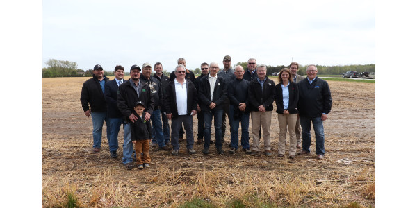 After listening intently to farmers and agronomists explain the benefits of cover crops and a manure digester at the farm, Evers seemed impressed. (Courtesy of Peninsula Pride Farms)