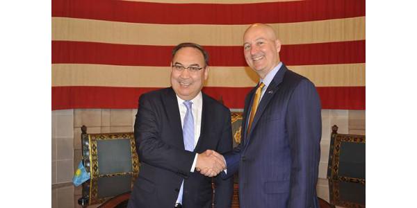 Gov. Ricketts shakes hands with Ambassador Erzhan Kazykhanov during the Kazakh delegation's visit to Nebraska. (Courtesy of Office of Governor Pete Ricketts)