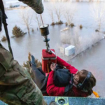 The Nebraska National Guard conducts an airlift rescue mission during the March floods. (Courtesy of Office of Governor Pete Ricketts)