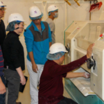 Participants of the IAOM-KSU Advanced Milling course make adjustments to the reduction rolls during a starch damage exercise. (Courtesy of KSU)