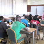 Mike Retallick, chair of the Iowa State University agricultural education and studies department, working with plant breeding master of science students at Makerere University in Kampala, Uganda in the spring of 2017. (Courtesy of ISU)