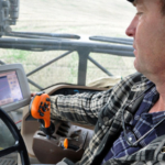 Oregon wheat grower Tom Sorey uses a sprayer equipped with GPS technology to help him minimize the overlap of chemical applications. (Courtesy of NRCS Oregon via Flickr)