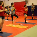 Youth participate in a yoga class. Healthy living is a 4-H program area. (Courtesy of ISU Extension and Outreach)