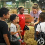 Children at the Great Dairy Adventure learned about what cows eat. Families, children on field trips from daycare centers and summer camps and the general public had the opportunity to milk a cow, create art projects and enjoy free dairy treats. (Courtesy of UDIM)