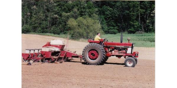 Farmer planting corn in SW Michigan. (Courtesy of MSU Extension)