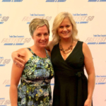 Lara Durben, MPF Communications Director and Teresa Sorenson, MPF Events & Exhibits Manager, receiving the award on behalf of MPF in Atlantic City, NJ and logos from TSE. (Courtesy of Midwest Poultry Federation)
