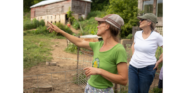 April Prusia giving a farm tour. (Photo credit: Will Scully)