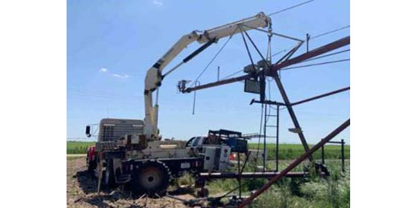 Jarrod Tuttle applies irrigation technology skills in replacing a center pivot tower leg at his summer internship. (Courtesy photo)