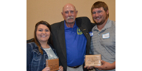 """Paige Twohig and Lucas Kolterman received """"Leave Your Mark"""" awards from the Aggie Alumni Association, presented by NCTA alumnus and instructor Dan Stehlik. (NCTA Photo)"""
